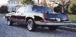 Rear shot of a black 1986 Hurst/Olds