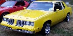 Yellow 1984 Cutlass lowrider.
